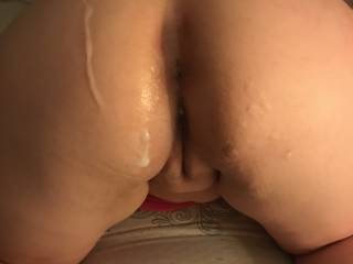 Freshly fucked with cum in her pussy and on her ass.