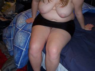 Sitting on bed with tits out & short skirt