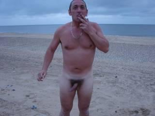 Me trying to pretend that i wasnt cold.. BRrrrrr....   6:30am,,  and England southeast coast weather.. LOL... I lost at a game of cards after a busy night on the beer & JD\'s,, so she said my forfit was to get naked, go through the dunes and onto the beac