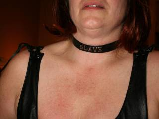 """I had to blindfold her until the temporary tattoo dried. I didn't want her to know which one it was. The slave collar is there just because she looks hot in a """"slave"""" collar"""