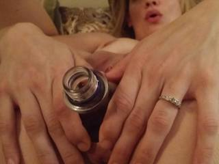 Her pussy and vagina make a fantastic bottle holder. She can serve me a vodka martini any time (infused with her own special vagina juices, please -as dirty as it can be-) I love her wedding ring.