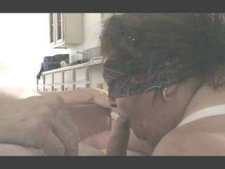 Big Gloria blindfolded on her knees , being directed by Mario how to savor and suck his  throbbing cock