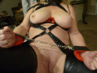 We just got new bondage outfit...Now to practice, practice. Would love to get someone come in while blindfold is on. Suck here tits and eat her sweet pussy.