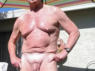 Private patio. Can't help but get naked. Would like to hear from other male nudist.
