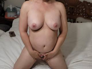 Nude on bed about to play with my little lady for you guys