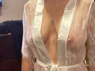 A sheer white robe that will be covered in my squirt and his cum
