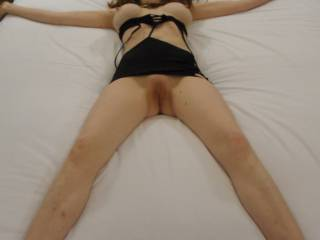 I would tie this beautyful sex-doll to the be just in this position. Then starting with licking and sucking her well-used cunt. For the next, I will lay on her, pushing my rock-hard cock into her wet vagina, and fuck her deep and hard, squeezing, pulling her tits, biting and sucking her hard nipples, till she get an shivering screaming orgasm. Of course, in the process, I have filled her vagina with full load of sperm.
