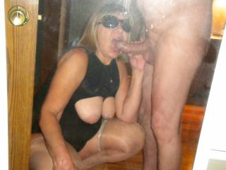 My hotwife gets on her knees and poses for a photo as she sucks on this guys cock! I watched and took photos as he fucked my wife's mouth before fucking her married pussy! Doesn't she look great sucking that big cock with her tits out?
