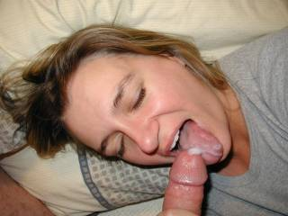 Fuck yes !! Keep feeding her, luv to see more cum in her sexy mouth ! Very hot gal !