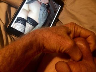A friend sent me this photo of his wife and asked me if I thought her sexy, I thought I'd show him.  Love squeezing my balls as my cock gets hard.