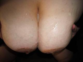 Great load all over her beautiful tits.  They sure are perfect for sucking, fucking, and covering in cum.