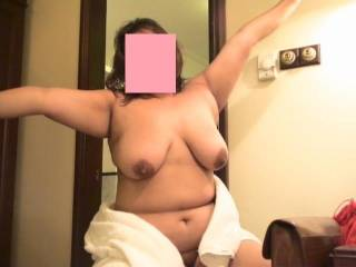 wife stretching our her 42D boobies