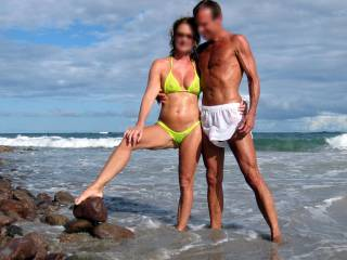 Great photo of such a hot couple enjoying each others beauty and the natural scenery of the surf in the back ground is incredibly erotic!  Everyone viewing will be clearly liking the mesmerizing view!