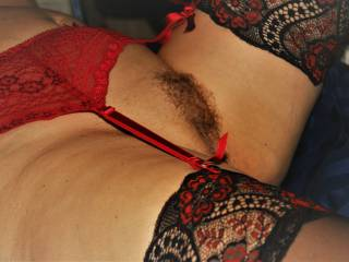 I like red lingerie and lace stockings. Do you like red and black around my pussy?