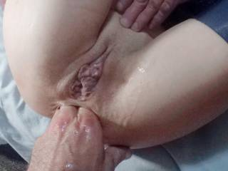 He fucked my pussy with both toys in my ass and it didn't take him a minute to blast his load deep in my hot cunt. Then he rolled me over onto my back and proceeded to tickle my tonsils from the backdoor.