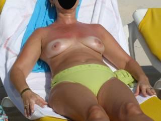 I love it when she shows her tits at the beach, makes me soooooo horny