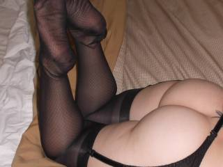 Danielle posing her sexy ass and legs in sexy black vintage silk stockings.