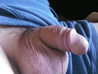 Just sitting around with my limp cock hanging out.