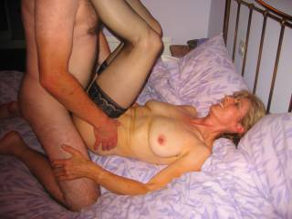 I love her legs over my shoulders I can slide in really deep into her hairy wet cunt,whilst watching her mature tits jiggle about
