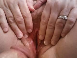 Spreading my married pink lips for you. Hubby says married pussy is the best, and definitely very delicious.