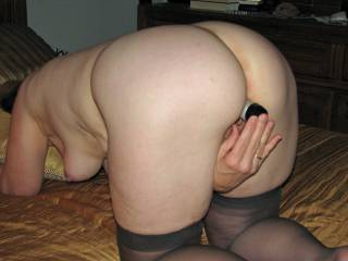 Those hanging tits are awesome.  I'd love to help her with that dildo.