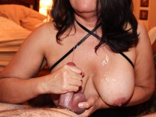 Working a 2nd cumshot on my tits from hubby's cock with a handjob.  You can still see the cum from my 1st attempt on my mouth.  I had worked and edged him well and had his balls full of cum!