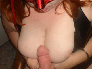 Those tits sure are perfect for that, but they're even better for covering with cum.  Very nice, thick cock too.  Bet it feels great between those tits too.  Very hot pic.