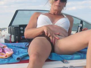 Gorgeous sexy hot woman showing off her fantastic hot pussy has me wanting to lick, suck, eat it for a more than amazing screaming orgasm, right there on the old boat!