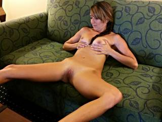 lovely tits (breasts sounds better)  great body shape, your pussy is to die for eating or fucking, and I love your sofa lol  you are one very hot sexy lady xxx