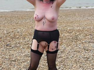Stockings and boots, topless on the beach at Normans Bay East Sussex. My Submissive at her best.  We DID get busted here..Lucky guy stopped and joined us for a while!