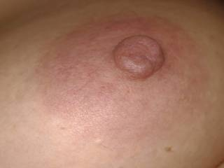 Perky nipple awaiting a nice tongue session