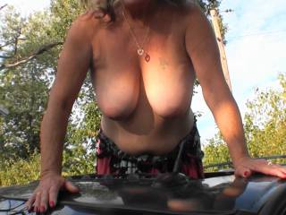 """Boyfriend asked me to show off the girls by standing in our SUV\'s moonroof, so of coarse I did. Thank goodness no neighbor drove by and caught me. Boyfriend also says that I have the nicest """"hangers"""" What do you think?"""