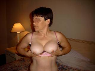 My wife exposing herself in pink lingerie.