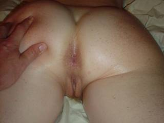 round, tight ass oiled.....beautiful pussy dripping from my massage.   This pussy stands alone for how she feels, the pleasure she gives