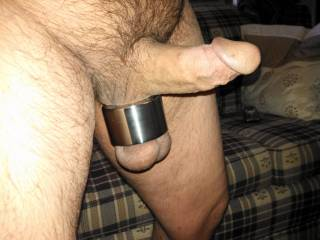 Making hubby pose with his new ball stretcher, it weighs them down nicely. What do you think ladies, wanna give my hubbies cock a try?
