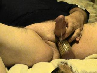 These last 4 photos are from my latest video. I managed to get 11 rings on my balls, now that is a lot of stretch and weight. Cumshot is dripping down onto my balls.  How does it look??