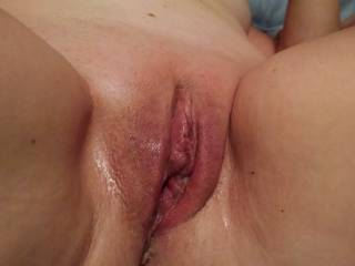 My wife\'s pussy after being hammered by her huge dildo.  So wet and worn out.