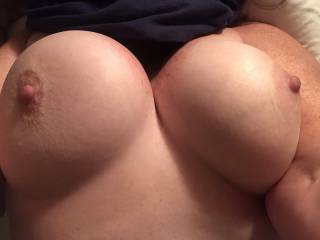 Another view of my all-natural girl. Her tits are so soft. I love them, but she wants them enhanced. She's a DD — what do you think, should she get enhancements?