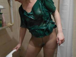 showering in tights and top