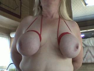 My friend Karen also loved it as I used my red cord to tie her big tits up like my trademark, close to the base so they bulge out nicely