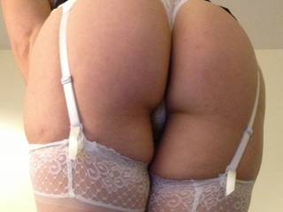 Garters make the perfect frame for my ass. Will you bend me over?