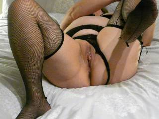 A few more in black lingerie. Lifting my legs up for easy access.