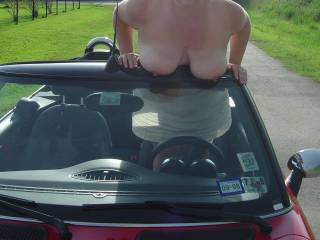 A man's biggest fantasy.  A topless car and a topless woman.  Who's getting topless next?
