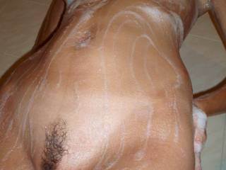You run the soap over my cunt and to my inner thigh... My trimmed big lipped pussy is hot and slippery... Your fingers start teasing my pussy fur, my clit and meaty pink lips... Will you rim my trembling slit with your tongue? Please?