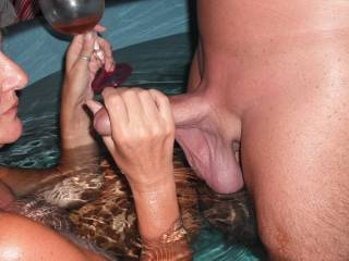 Playing with his nice smooth cock in the spa at home.