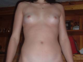 WOW what a great body love those little tits just perfect and very cute too.