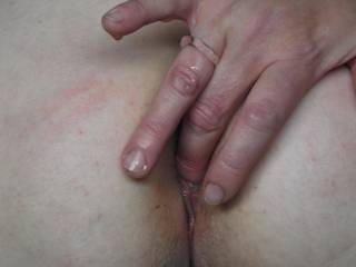 She likes to finger her ass when I fuck her from behind.