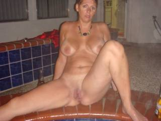 dam your lucky wow.  wish i was out by the pool also.  dam what a fine body.  like to enjoy every inch of her.  great breasts.