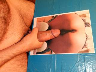 stroking my cock to cover that hot ass with my jizz