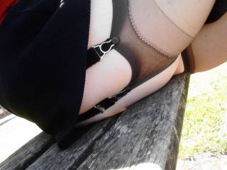 Mini skirt that shows off Sally's stocking clad thigh in public